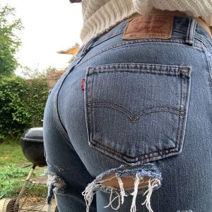 Vintage Levi's red tab distressed 505s w/butt rips